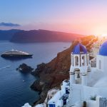 3D Blue domed churches at sunset, Oia, Santorini